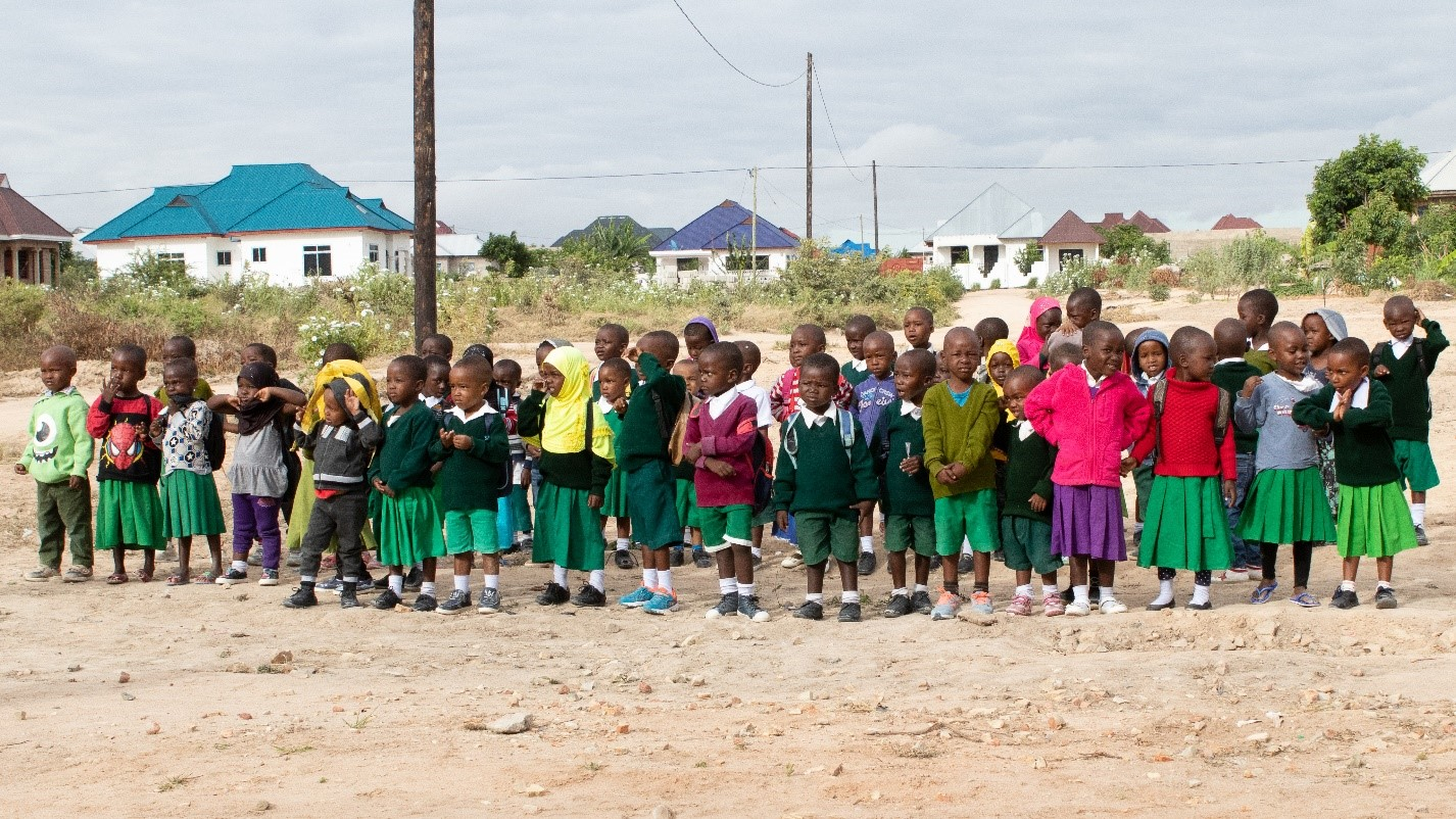 Ndachi school children greeting us as they did every morning